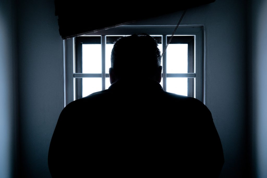 imprisonment silhouette man in jail